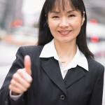 Businesswoman giving thumbs up