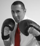07.28.14_Michael_Goldberg_Headshot_Boxing_Red_Tie_BW